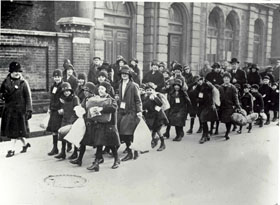 Children going on a Holiday Fund Outing, East India Dock, 1920s