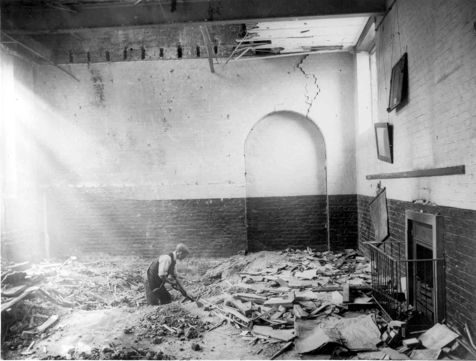 Cleaning the debris in a classroom of Upper North Street school after the raid on the 13 Jun 1917