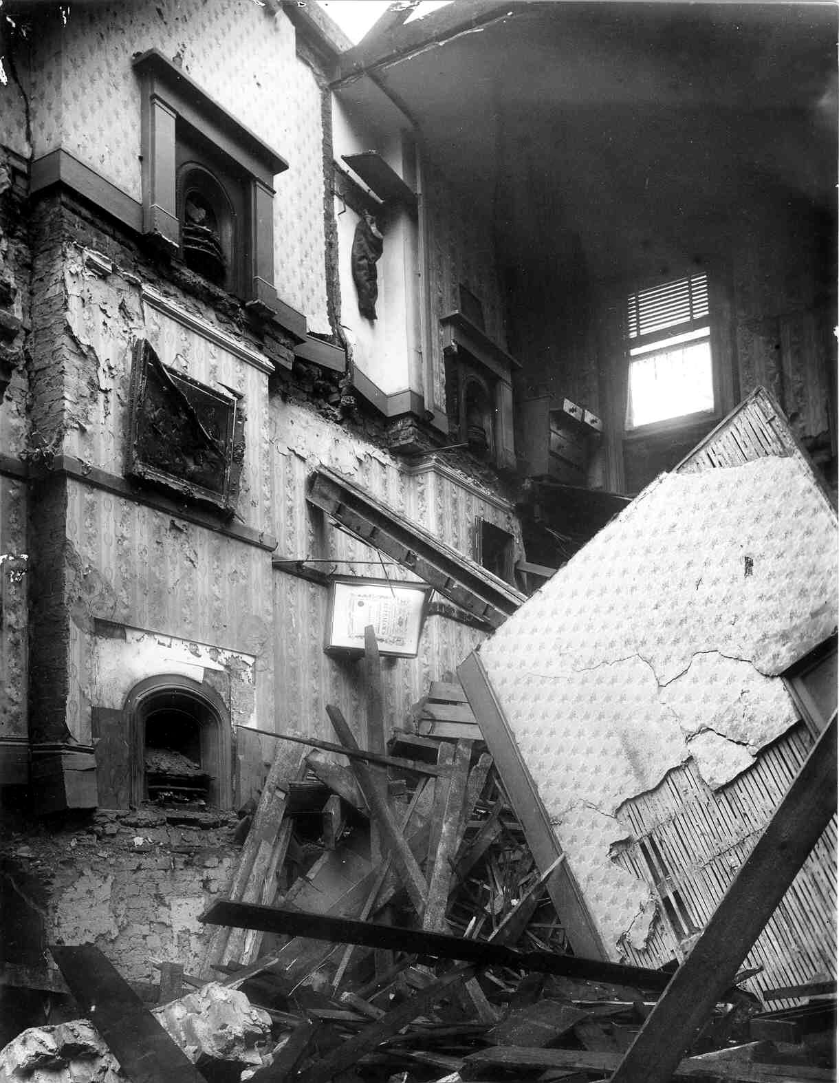 Damage done by Zeppelin raid 23 Sep 1916 to interior of the Black Swan public house, Bow Road