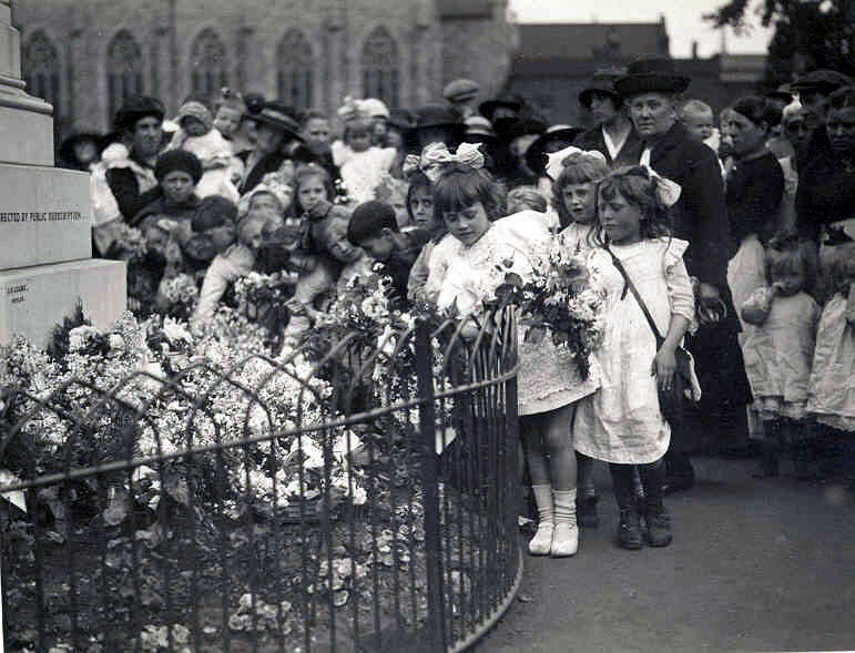 more children with their floral tributes at the Upper North Street war memorial unveiling ceremony, Jun 23 1919